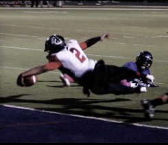 Football Player Diving